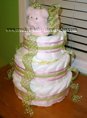 side view of girl pig diaper cake