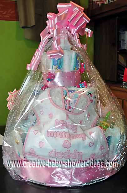 I love mommy and daddy girl bib diaper cake wrappe in cellophane
