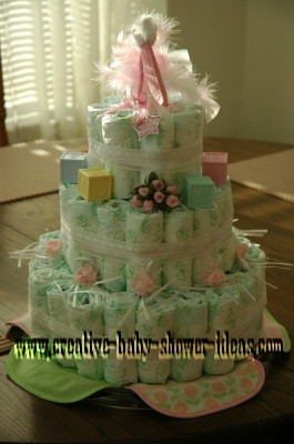 pink and green stork diaper cake