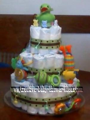 3 tier green and brown polka dot diaper cake with duck on top