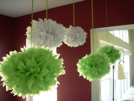 green tissue pom poms