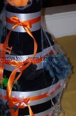closeup halloween towel cake showing cobwebs and black flowers