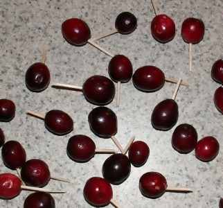 cranberries with toothpicks stuck into them