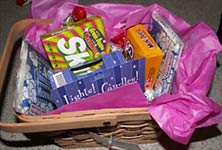 basket with tissue paper and movie night goodies