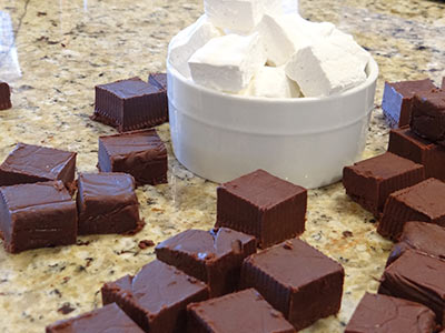 marshmallows and hot chocolate squares ready to be stacked