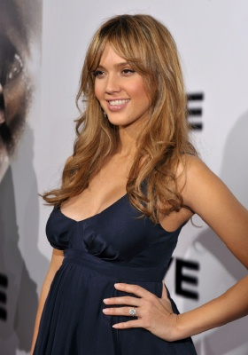 smiling pregnant jessica alba in dark blue dress
