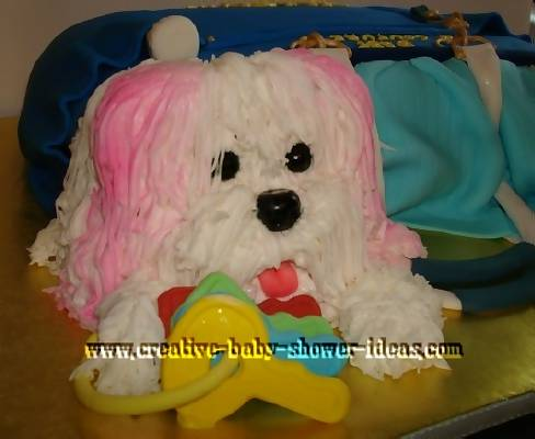 closeup up of puppy dog  and keys with juicy diaper bag cake