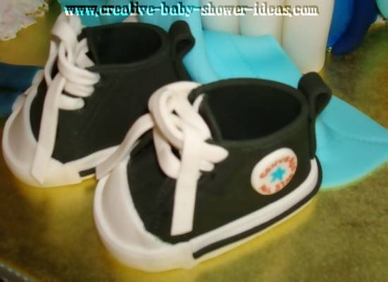 black baby sneakers with juicy diaper bag cake