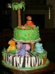 jungle baby shower cake with monkeys, hippos, lion and an elephant