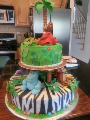 2 layer jungle animals baby shower cake with monkey and hippos