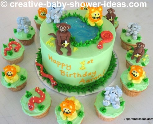 green jungle baby shower cake and cupcakes with fondant jungle animals