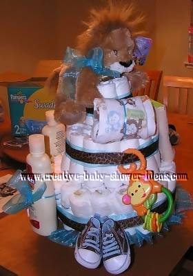 other side of lion diaper cake showing baby sneakers