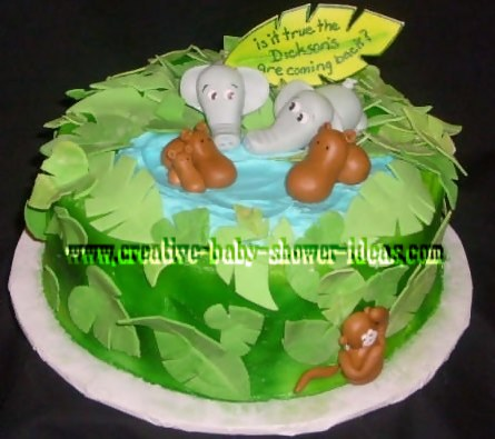 cute jungle baby shower cake with animals sitting in pond