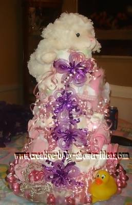 purple and pink lamb diaper cake
