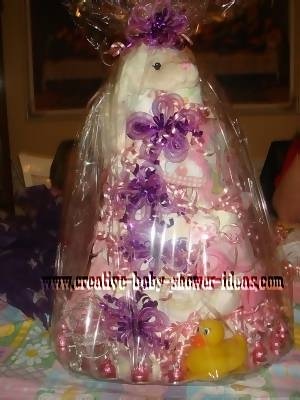 pink and purple lamb diaper cake wrapped in celophane