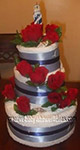 red and blue lighthouse towel cake