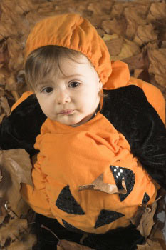 cute baby girl in a pumpkin costume