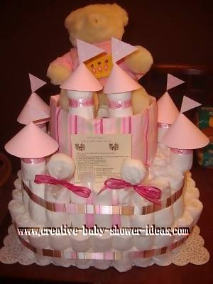pink lollipop castle diaper cake