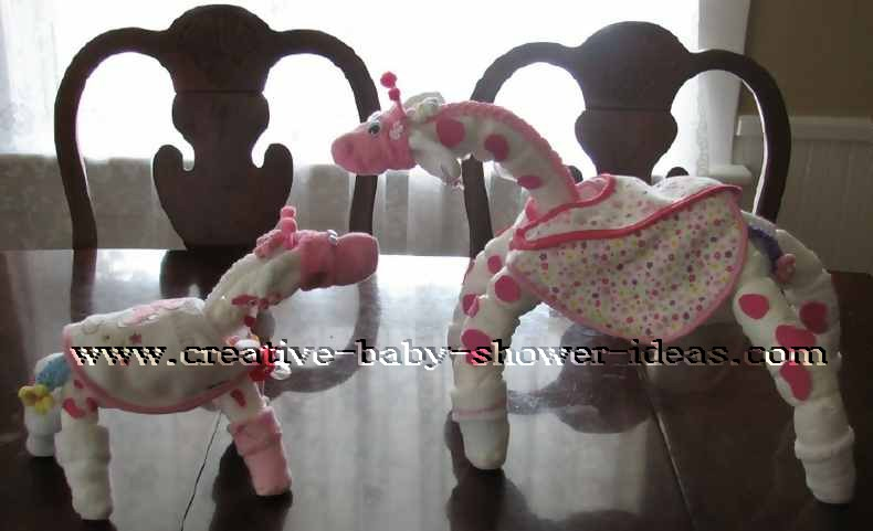 pink and white polka dots momma and baby giraffe diaper animals