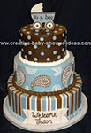 modern blue and brown baby shower cake with stripes paisley and polka dot designs