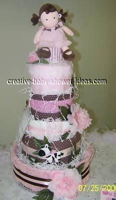 mod doll diaper cake on baby shower table