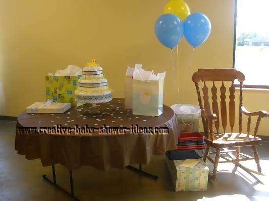 mod duck diaper cake on baby shower gift table