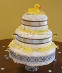 yellow duck diaper cake with blue and brown ribbon decorations