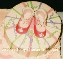 close up of baby shoes on mod mom cake