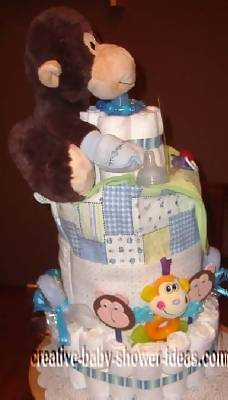 side view of monkey diaper cake