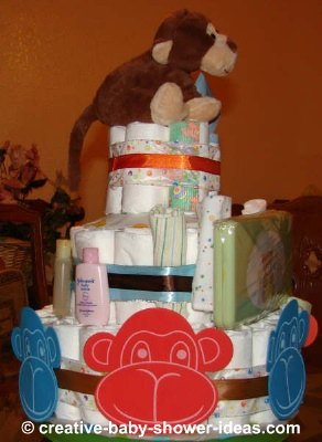 side view happy monkey faces diaper cake