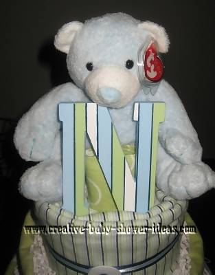 closeup of teddy bear and letter N on diaper cake