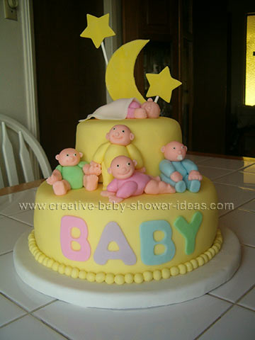 front of moon and star baby shower cake with the word baby on front