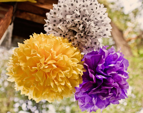 purple and yellow tissue pom poms
