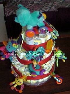 side of colorful animals diaper cake