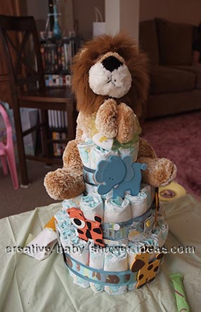 lion diaper cake with wooden animals