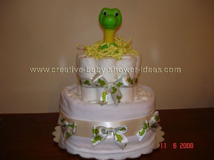 green dinosaur nappy cake