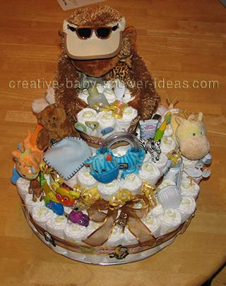 top of gorilla nappy cake with toys
