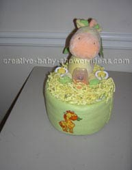 green and yellow giraffe diaper cake