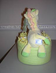 back of green and yellow giraffe diaper cake