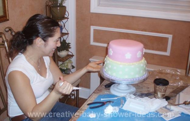 cake decorator making noahs ark baby shower cake
