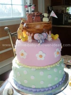 2 tier green and pink baby noahs ark cake
