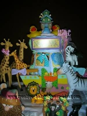 closeup of front of noahs ark diaper cake with animals