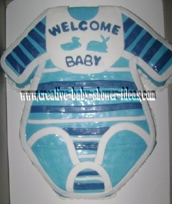blue and white onesie cake