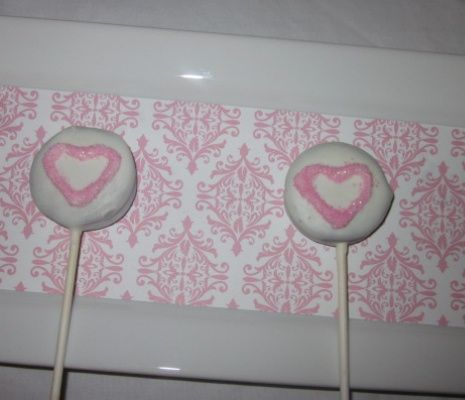 shite chocolate covered oreo lollipops with pink hearts