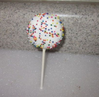 white oreo cookie pops with colored sprinkles