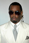 sean diddy combs in cream suit with glasses