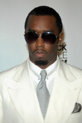 sean p diddy combs in white suit with glasses