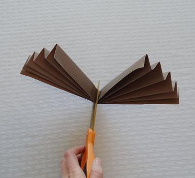 cut paper rosette in half
