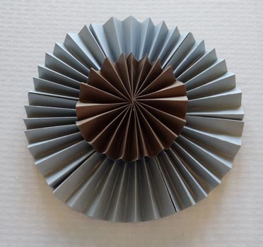 large and small paper rosette layered together