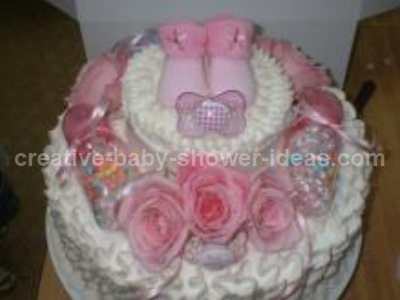 White Baby Shower Cake With Pink Baby Booties And Roses